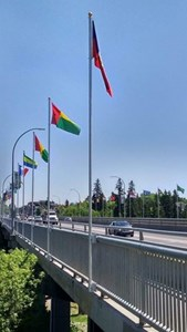 Flags on Whyte Ave's Mill Creek Ravine Bridge