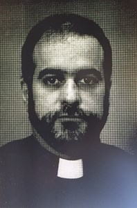 Priest charged in connection with alleged historic sexual assaults