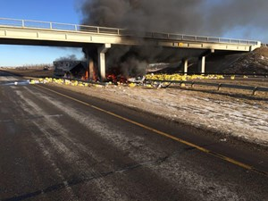 Driver in hospital after fiery semi crash on QEII