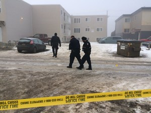 Police investigate scene at an apartment building north of downtown