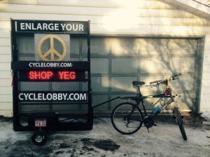 Edmonton cyclist fashions display cart for messages of peace